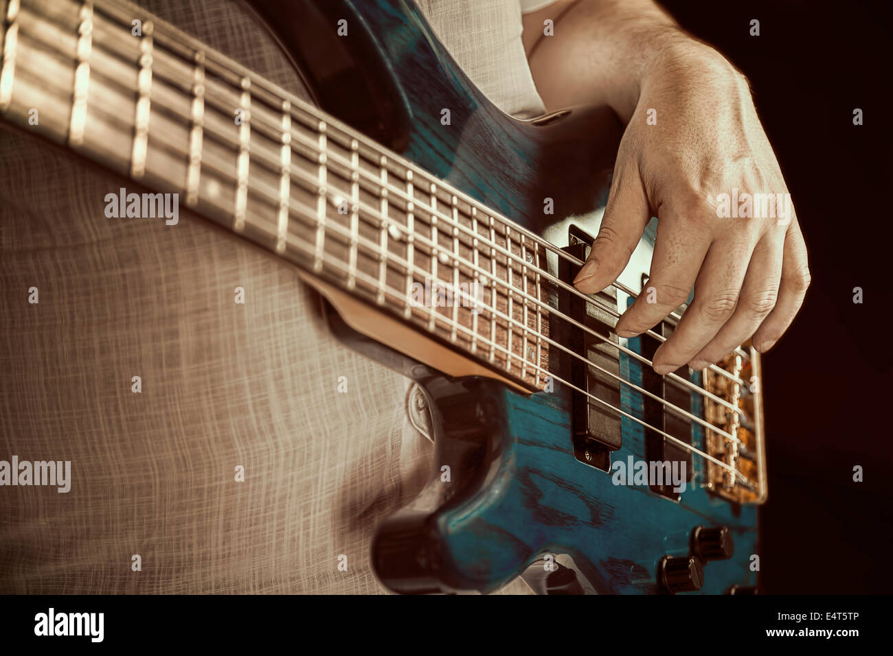 guitarist playing bas guitars, vintage image - Stock Image