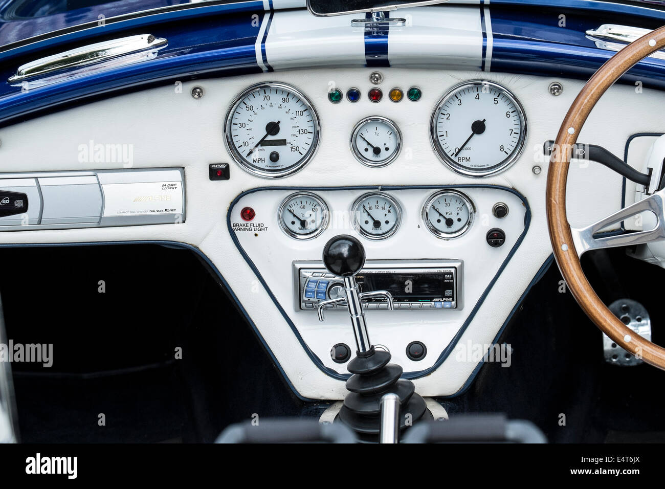Classic Cobra Sports car dashboard with traditional dials - Stock Image