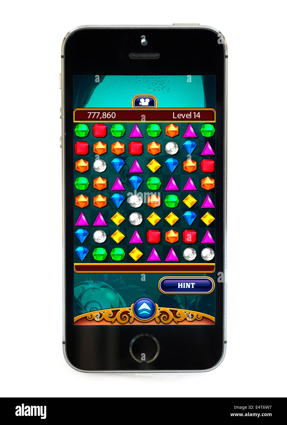 Playing the popular free game Bejeweled on an Apple iPhone 5S - Stock Image