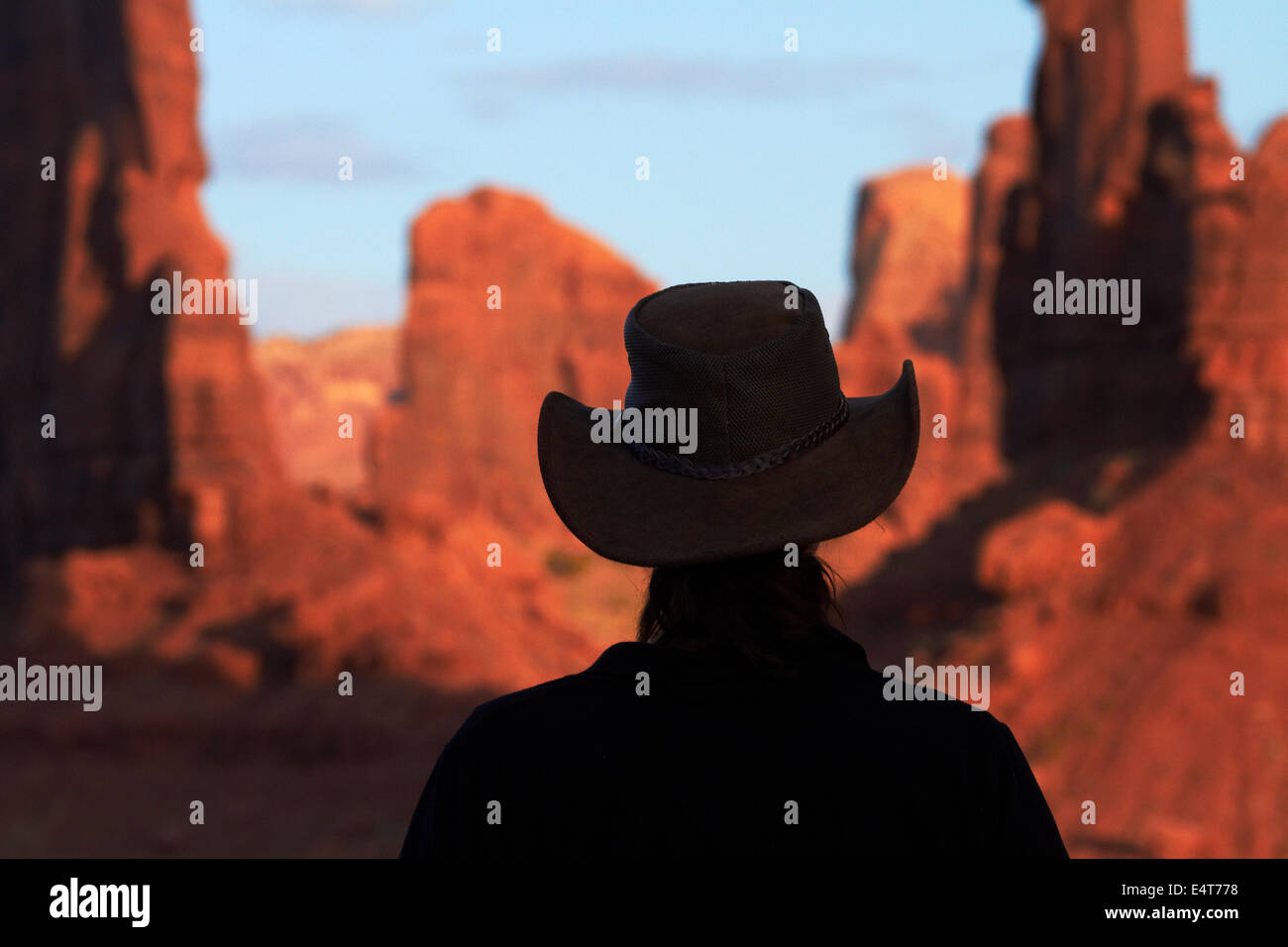 b42032b7a8d Tourist in cowboy hat and rock formations