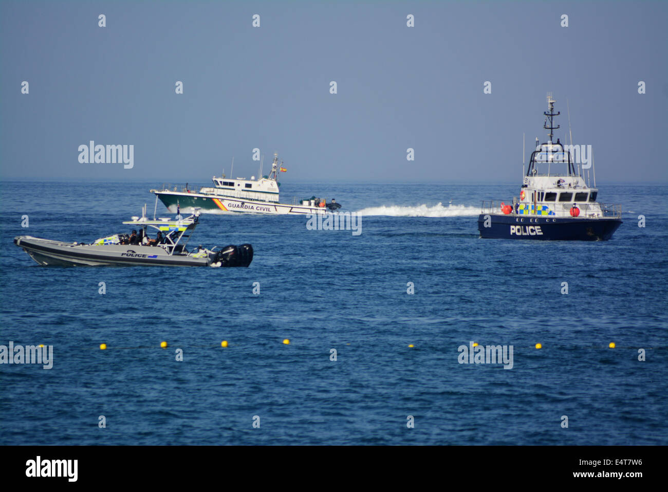 Gibraltar, 16th July 2014 - A Guardia Civil patrol vessel heads north past the east side of Gibraltar watched by - Stock Image
