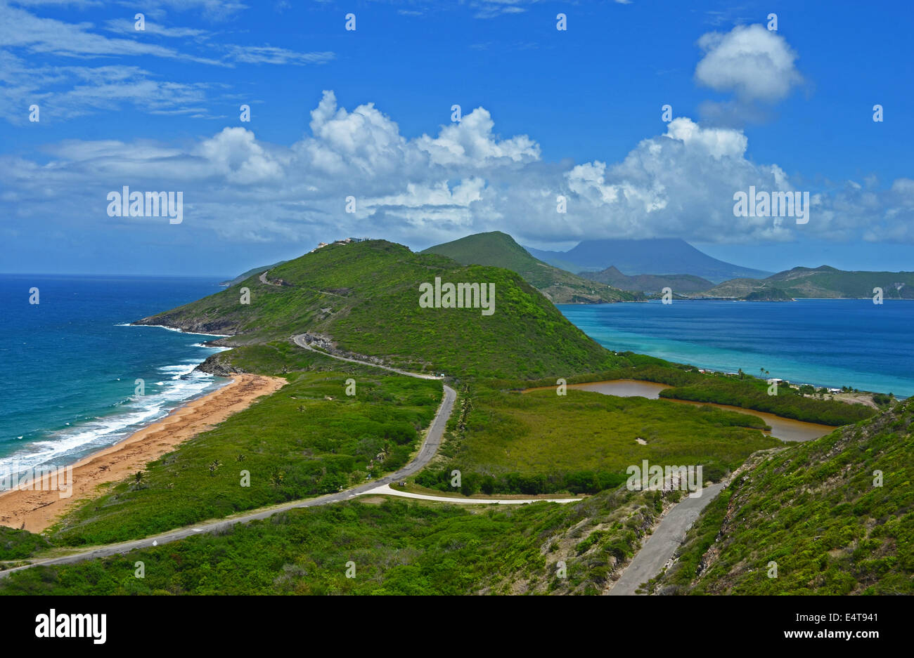 View from Sir Timothy Hill onto North and South Friars bays and beaches, St Kitts, with the island of Nevis in the - Stock Image