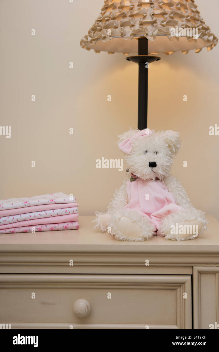 Stack Of Baby Blankets On Dresser Next To Teddy Bear And Lamp In Stock Photo Alamy