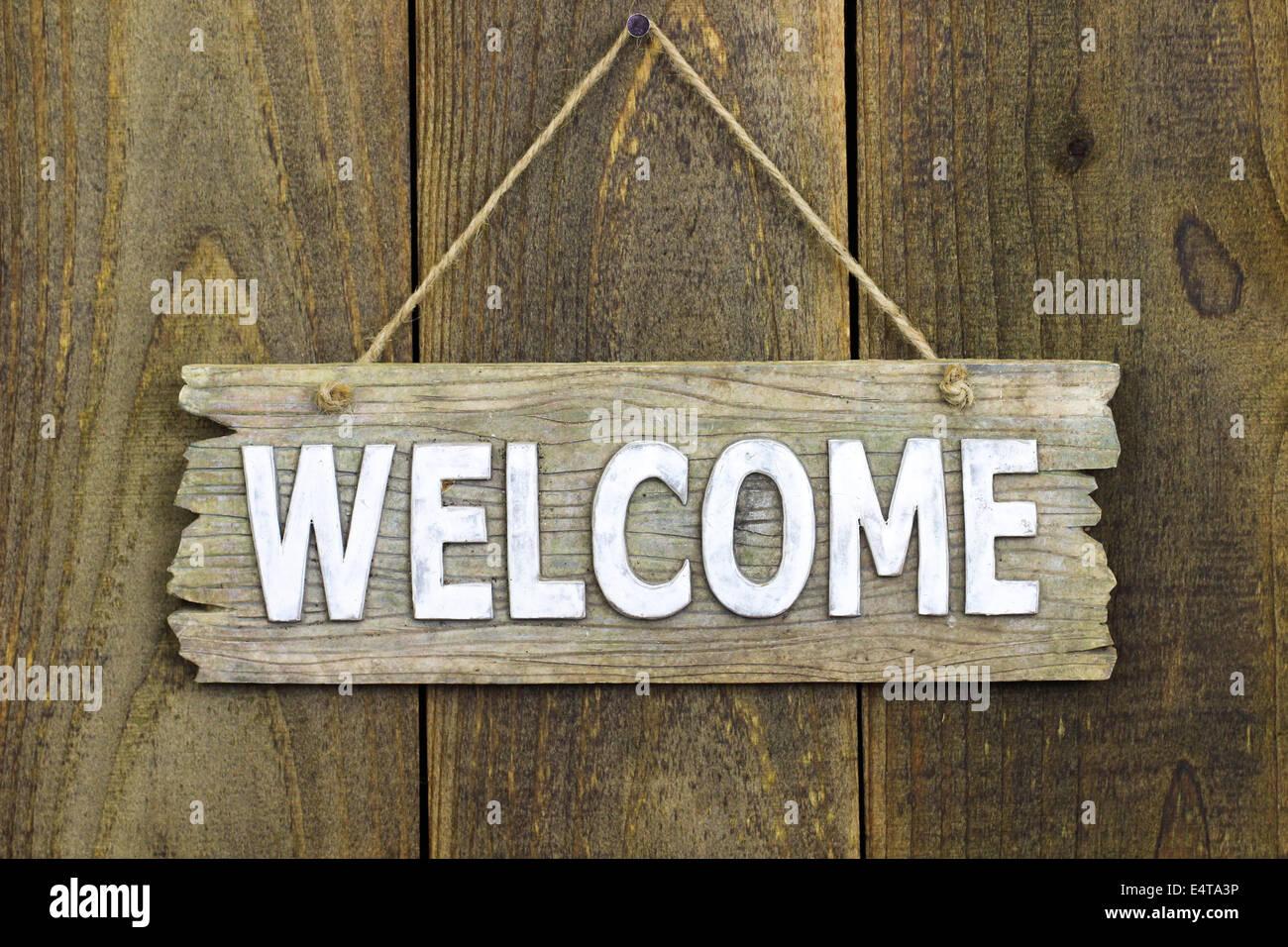 Rustic Wood Welcome Sign Hanging On Wooden Door Stock