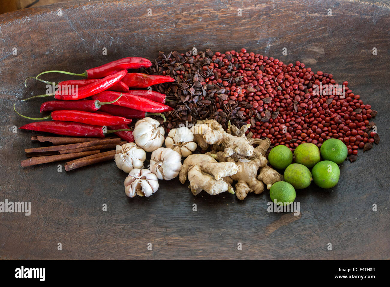Balinese Spices:  Garlic, Ginger, Chilis, Cinnamon, Limes, Star Anise, plus Saga Tree (Red Bead Tree) Seeds for - Stock Image