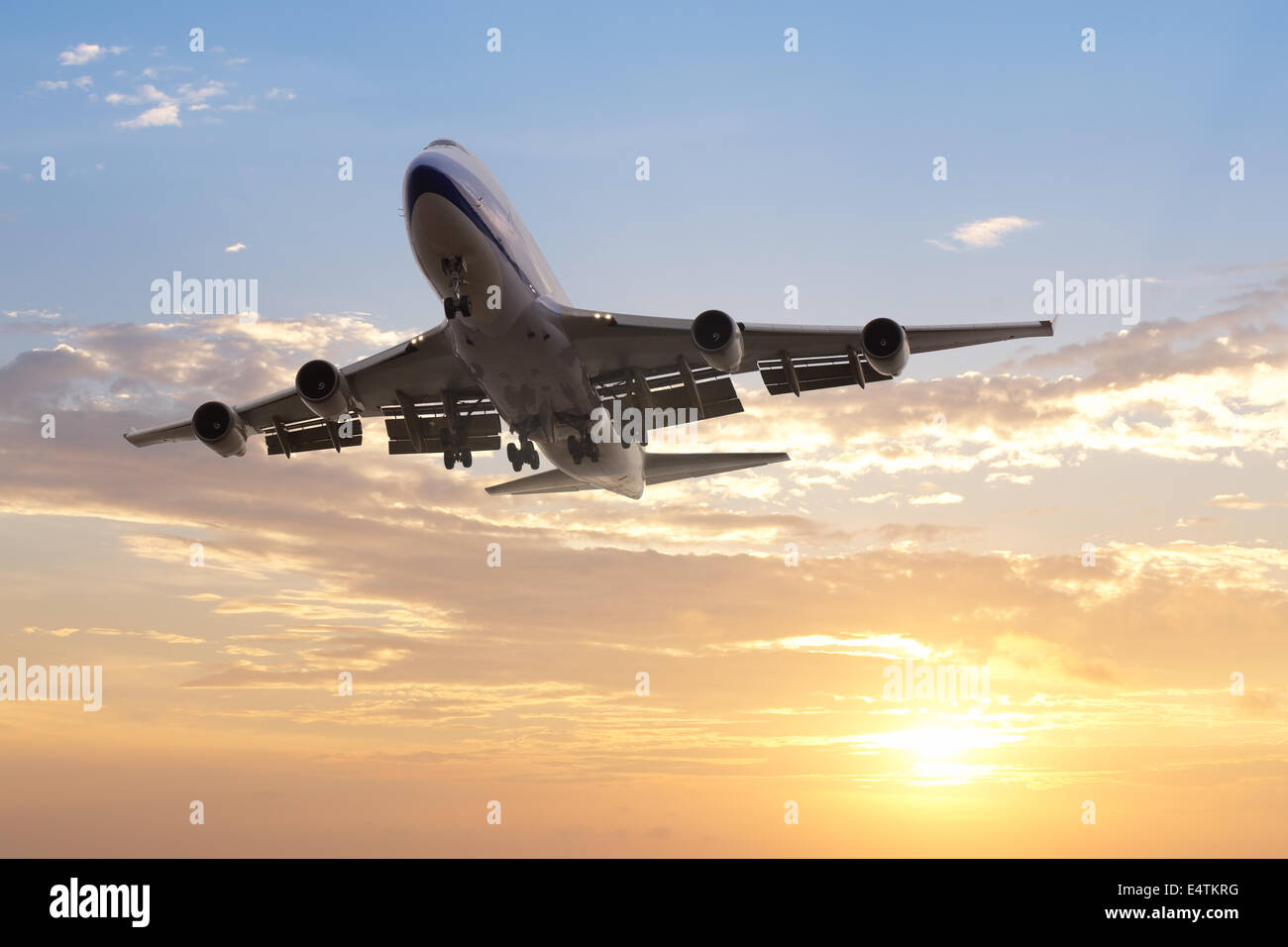aeroplane departed at dusk with dramatic sky - Stock Image