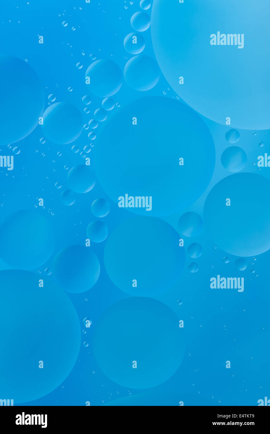 cyan bubble created by oil as background - Stock Image