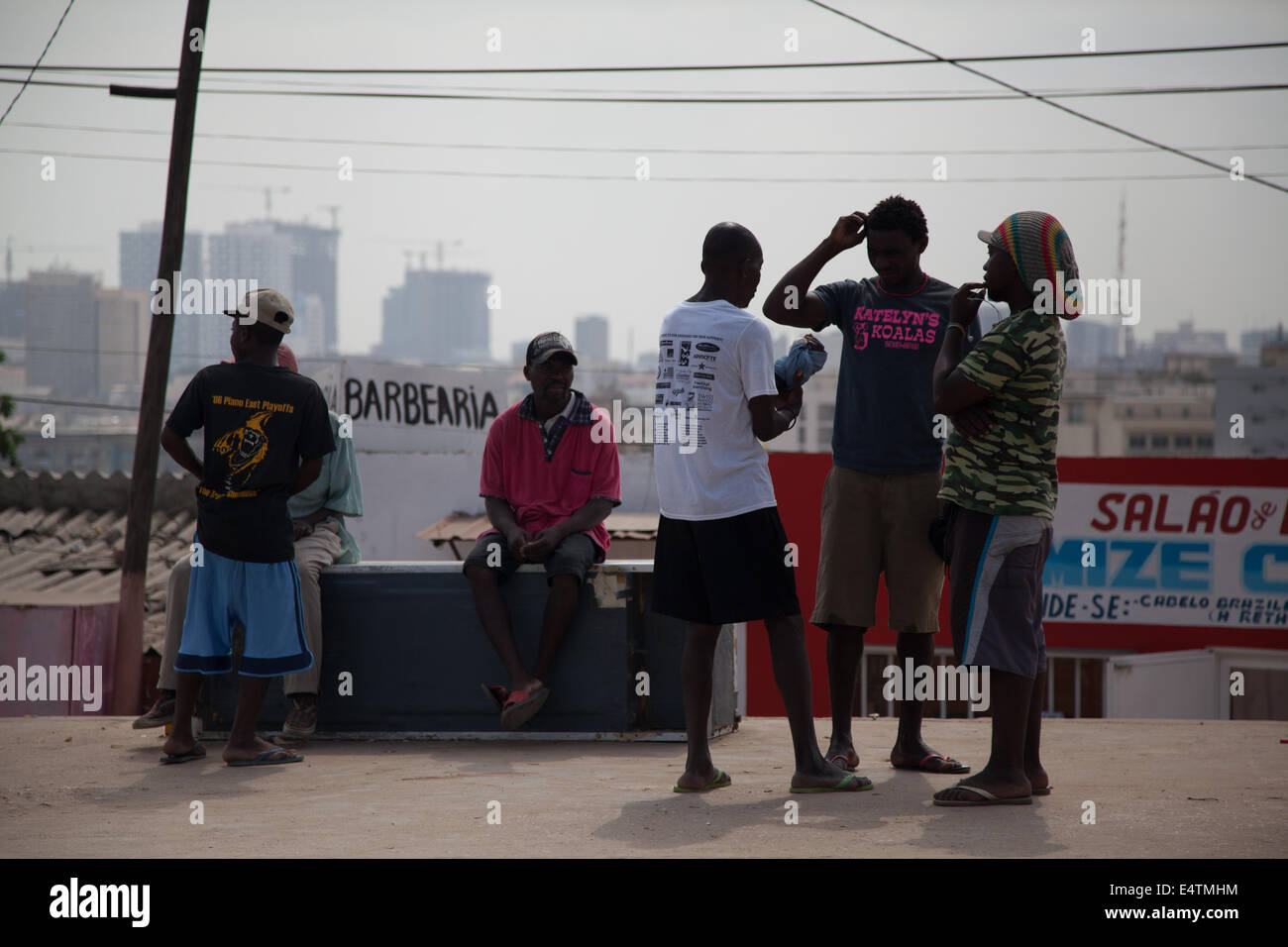 Angola, Luanda, city life Africa daily life pedestrians with city in background - Stock Image