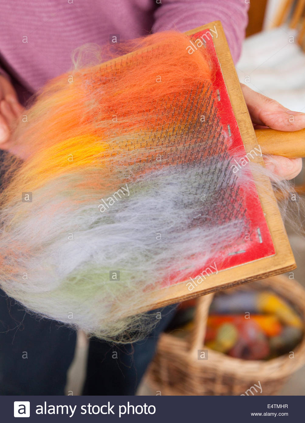 Carding - part of the spinning wool process at the Hebridean Woolshed at West Kilbride, Isle of South Uist, Outer - Stock Image