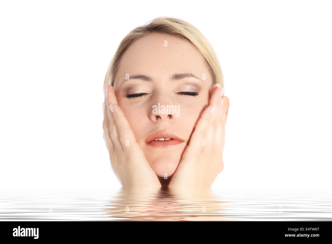 Beautiful blonde emerges from water - Stock Image