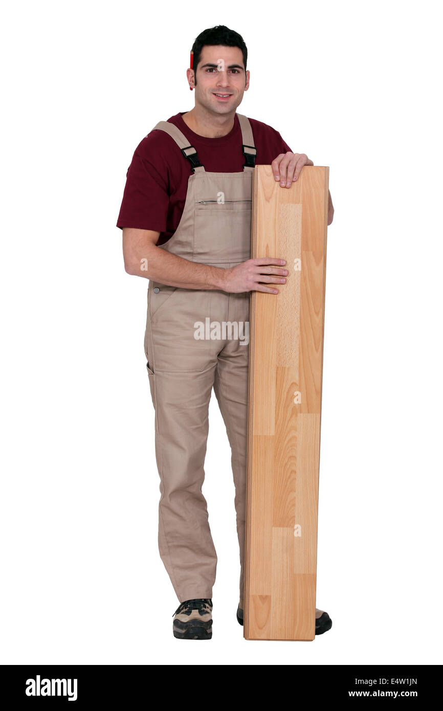 carpenter posing with planks - Stock Image