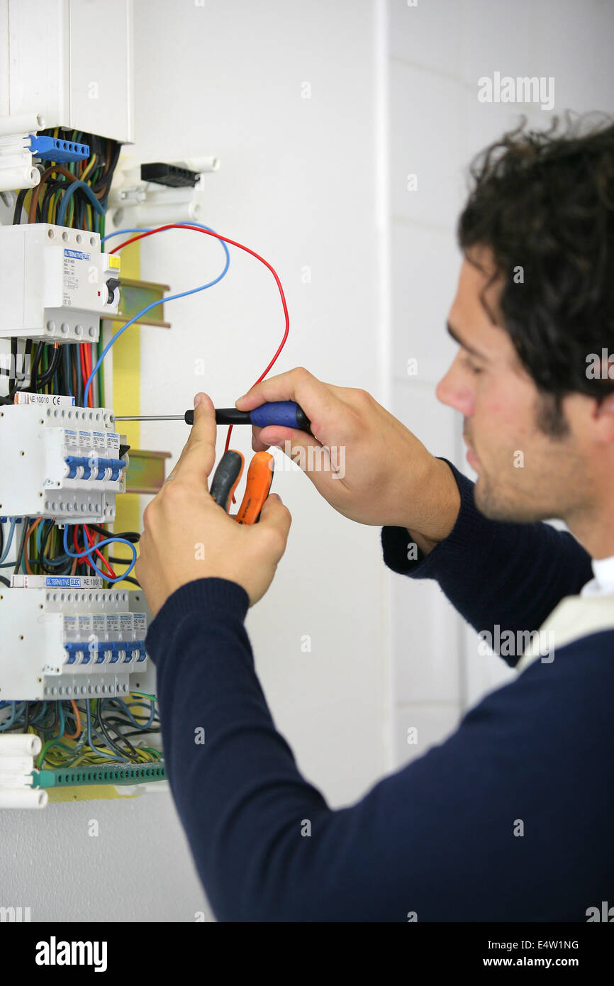 Faulty Electrical Fuse Box Stock Photos Wiring Man Repairing Image