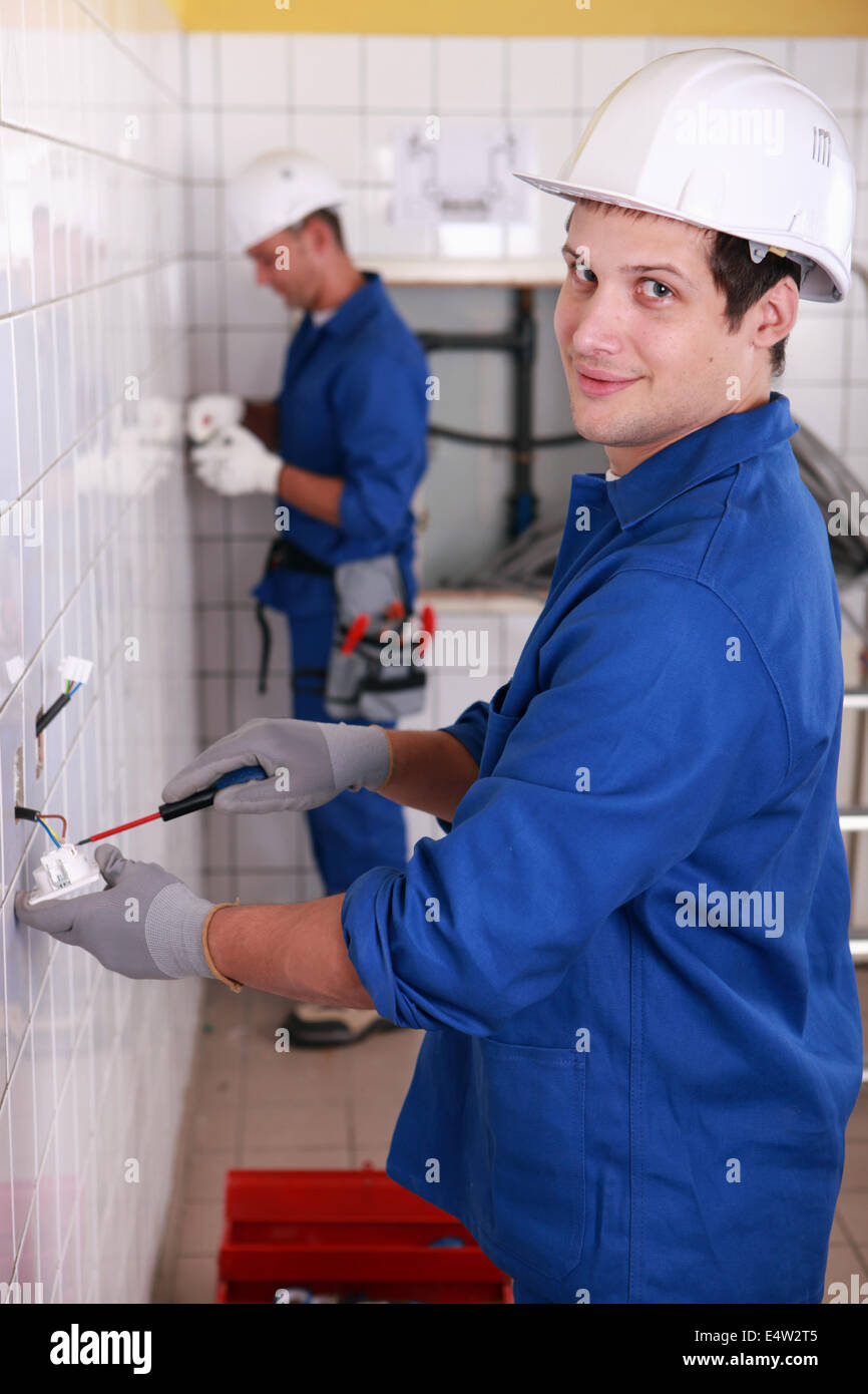 Electricians Wall Switch Stock Photos Wiring A Young Sockets Image