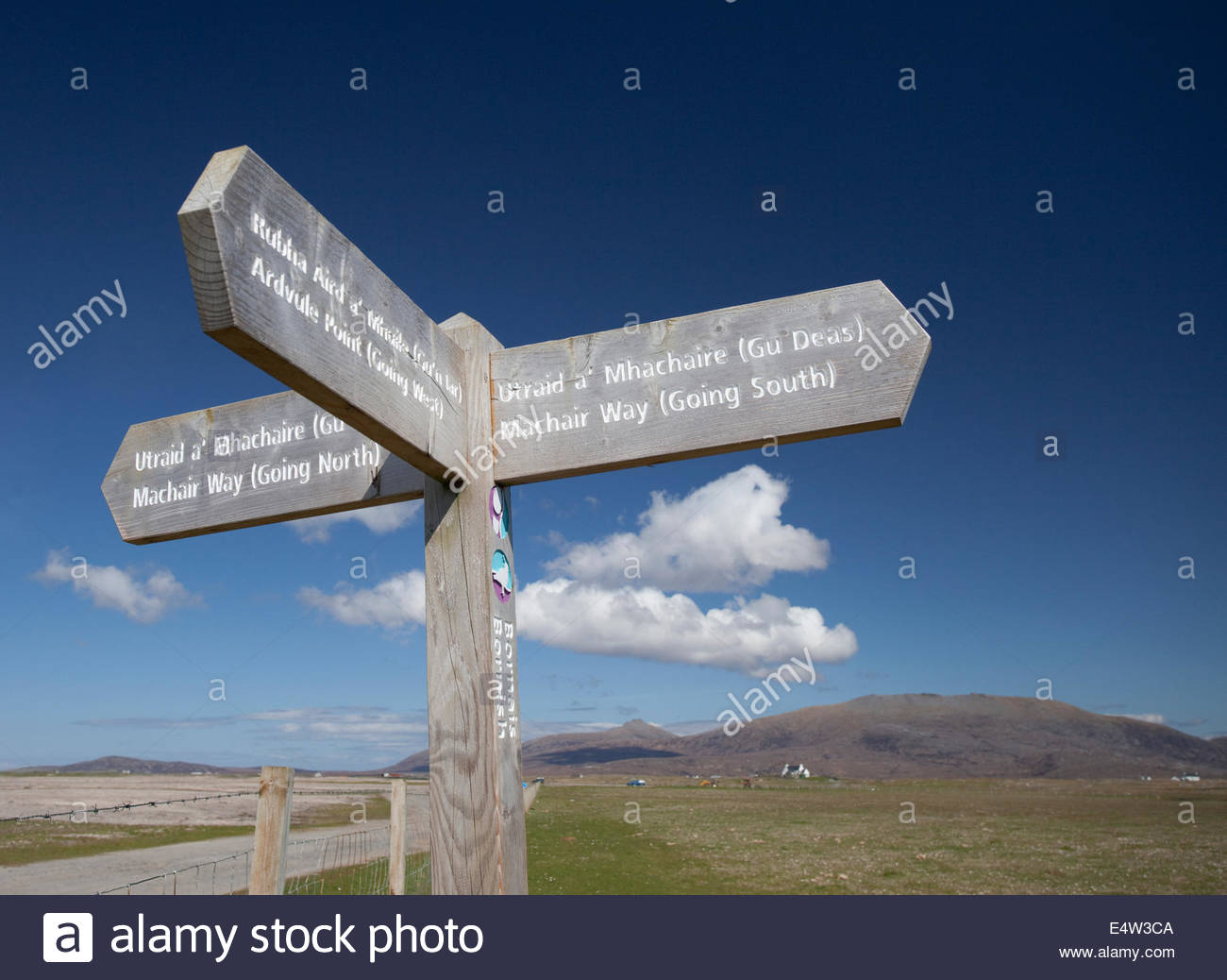 Wooden waymarker sign post  for the Machair Way, a walking route at Bornish, Isle of South Uist, Outer Hebrides, - Stock Image