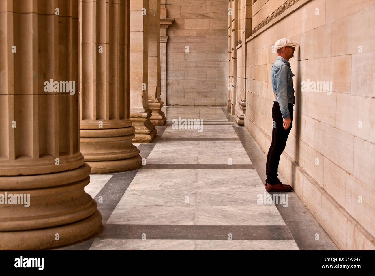 Arts Entertainer Mr James Everything standing face to the wall at the Caird Hall exhibiting one his new projects - Stock Image