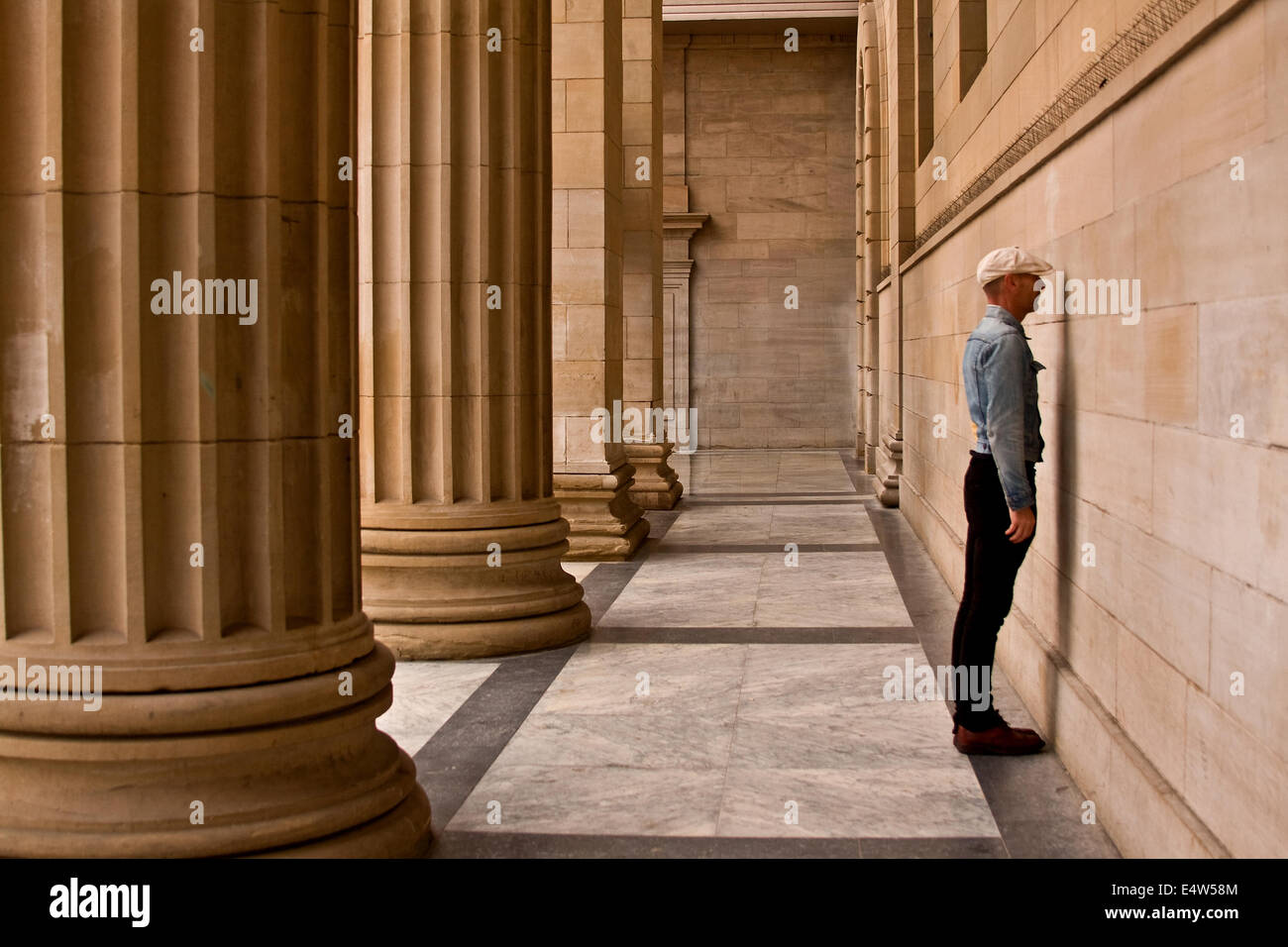 An Arts Entertainer Mr James Everything standing face to the wall at the Caird Hall exhibiting his new project in - Stock Image