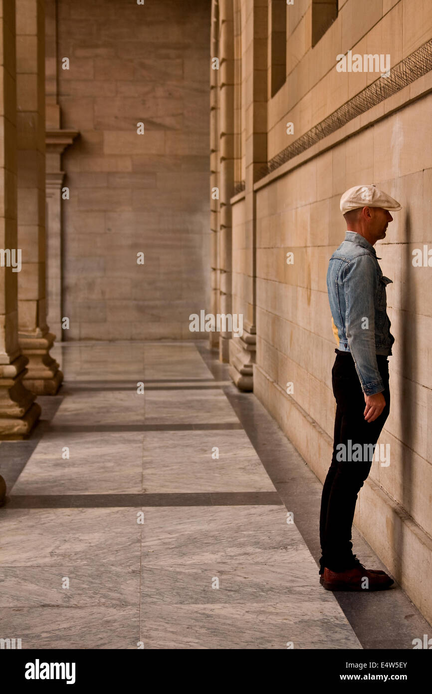 Arts Entertainer Mr James Everything standing face to the wall at the Caird Hall exhibiting his new project in Dundee, - Stock Image