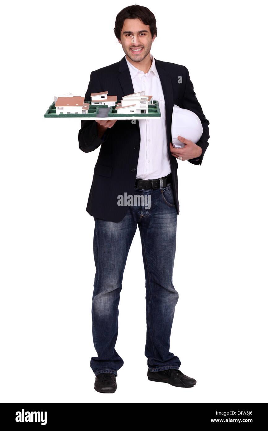 Architect holding scale model - Stock Image