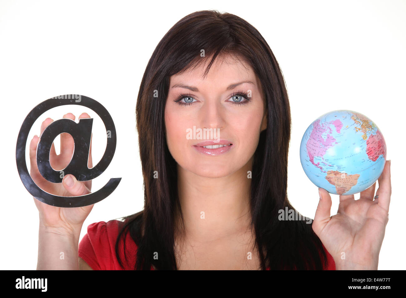 Woman holding globe and at symbol - Stock Image