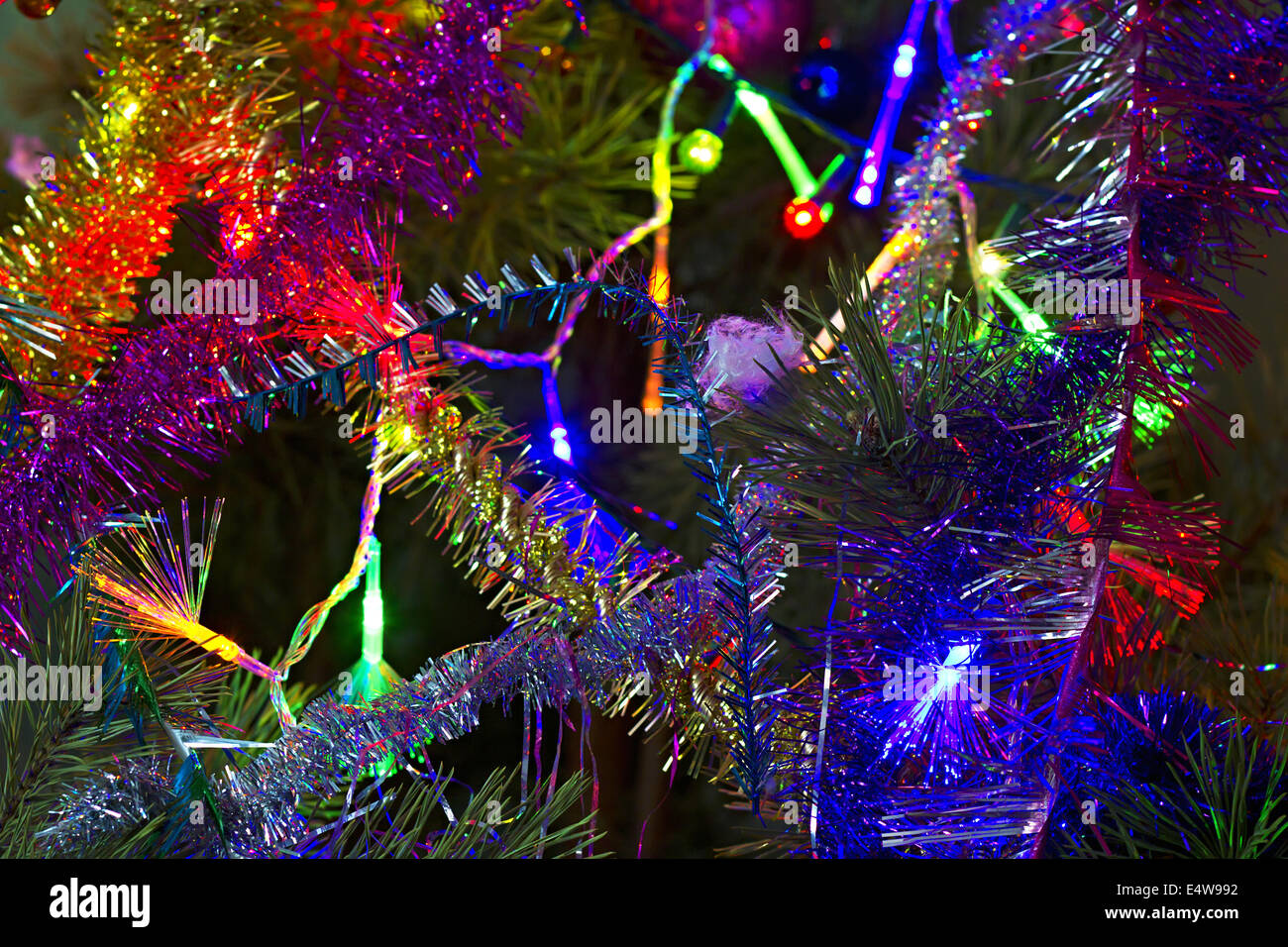 Christmas background of tinsel and garland - Stock Image