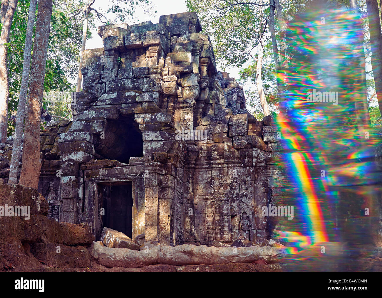 a ruined temple in the woods at Angkor Wat, shot through a prism - Stock Image