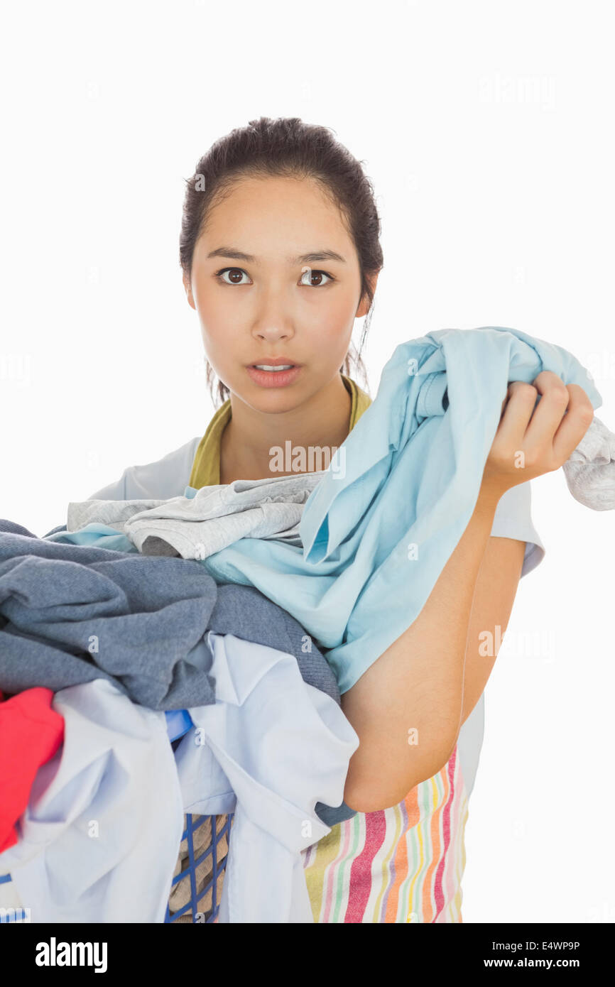 Tired woman holding dirty laundry - Stock Image