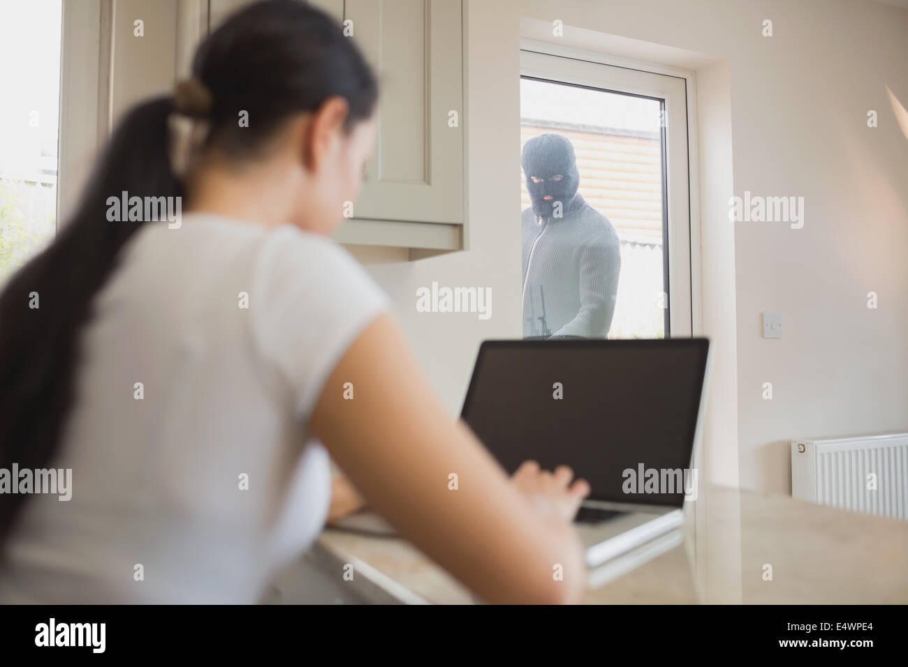 Burglar Looking Through Glass Door Stock Photos Burglar Looking