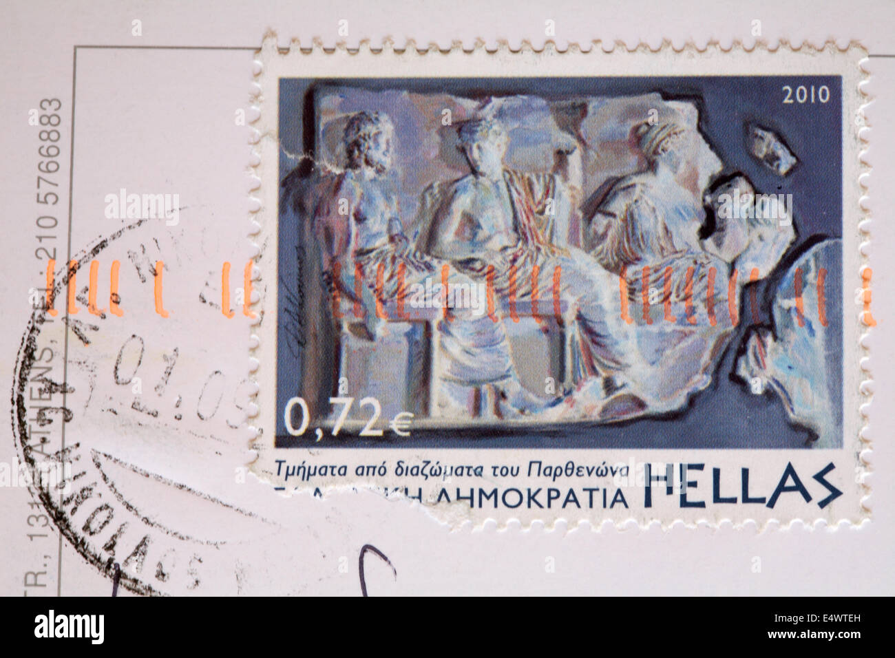 Greek stamp stuck on postcard - Stock Image
