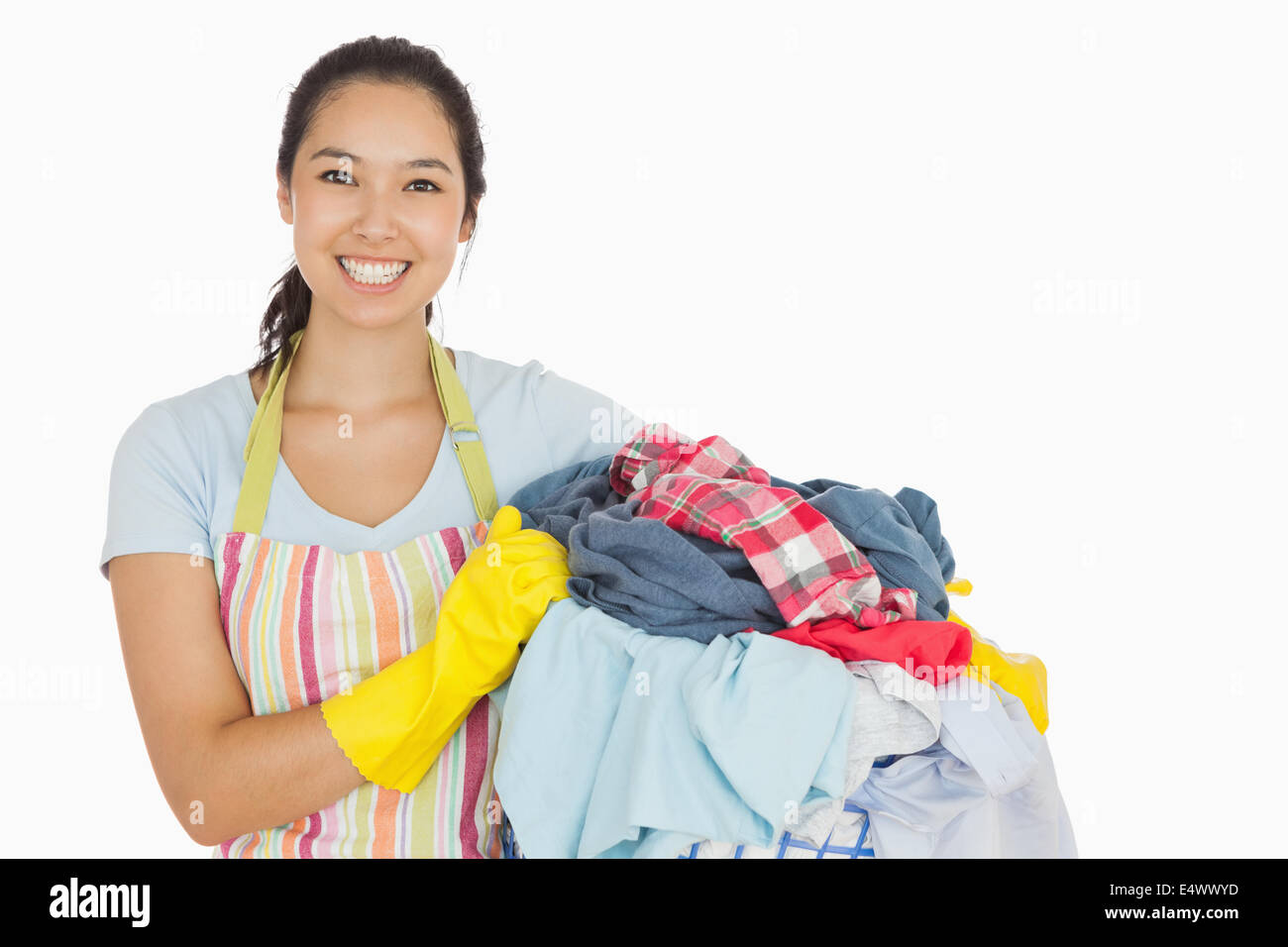 Laughing woman holding laundry basket - Stock Image