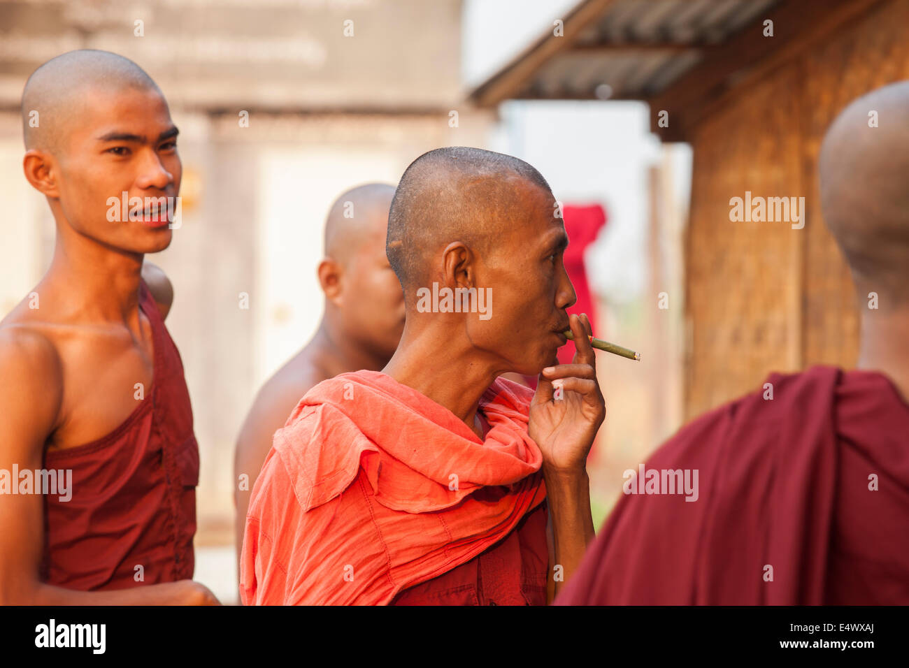 Older monks at a small monastery in Bagan, Myanmar. They oversee a group of pre-teen monks. - Stock Image