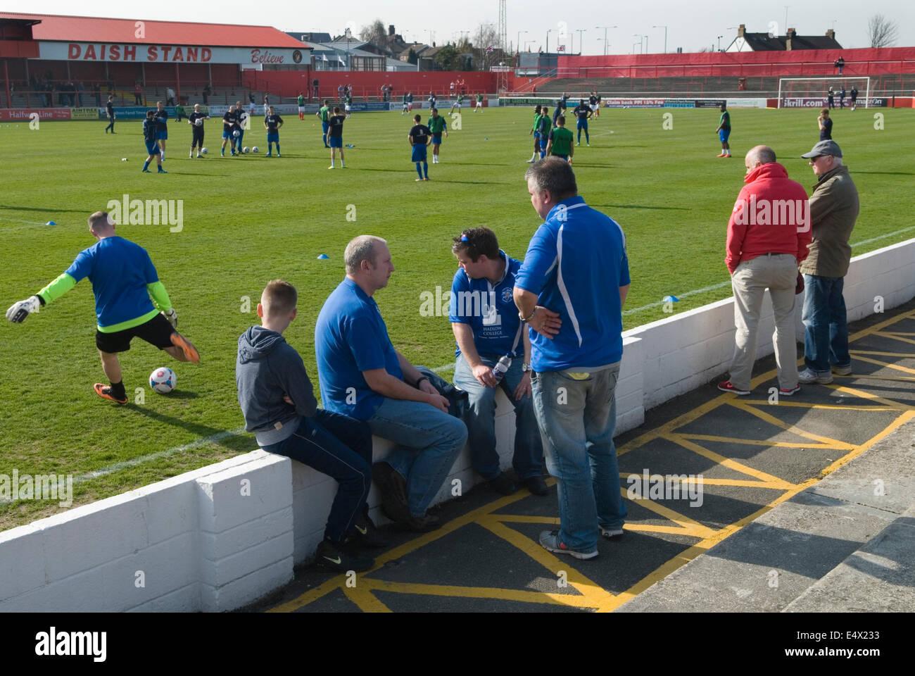 Kicking around before the start of a football game. Ebbsfleet v Tunbridge. Ebbsfleet Valley Kent UK.  HOMER SYKES - Stock Image