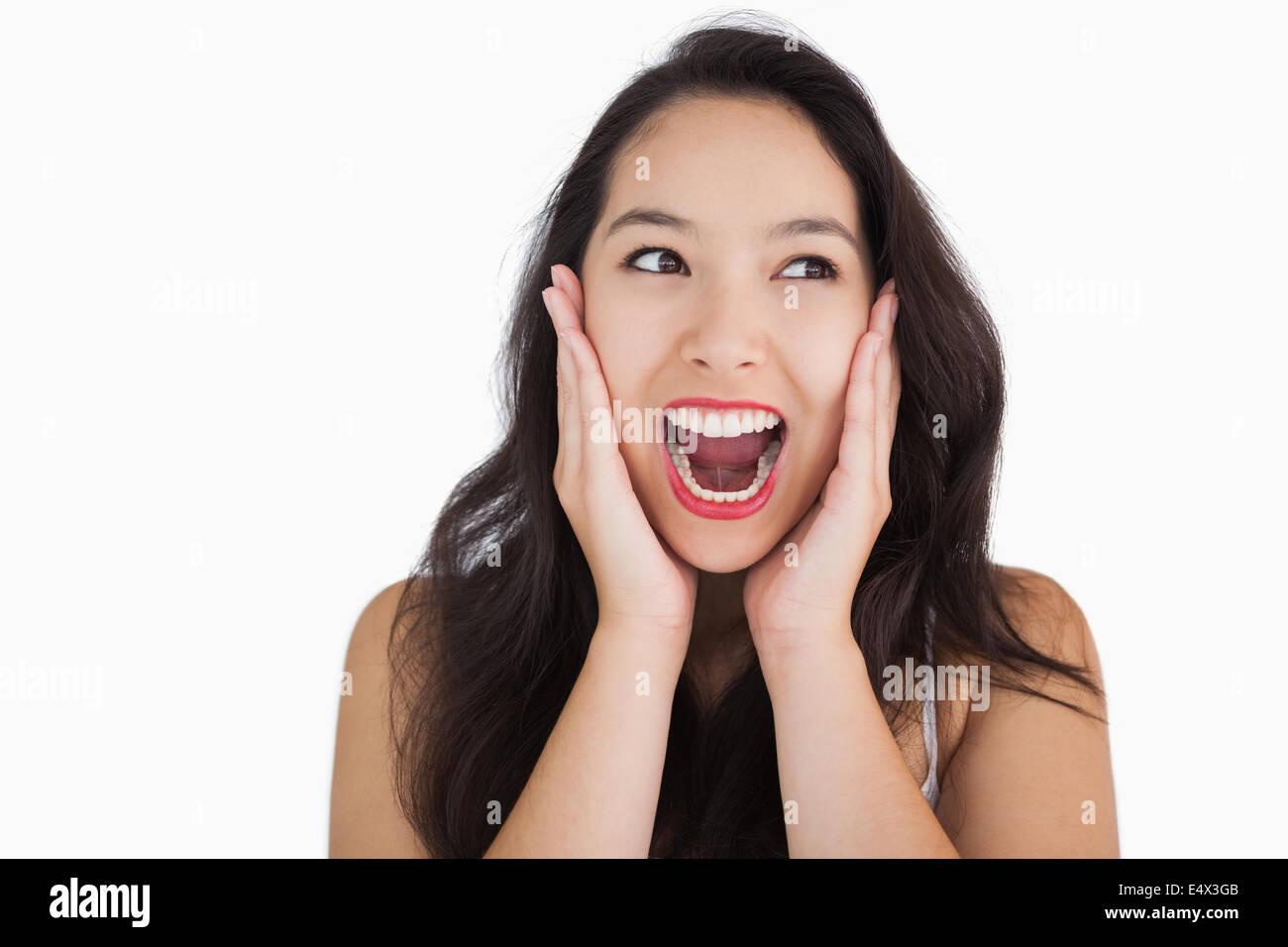 Smiling woman yelling - Stock Image