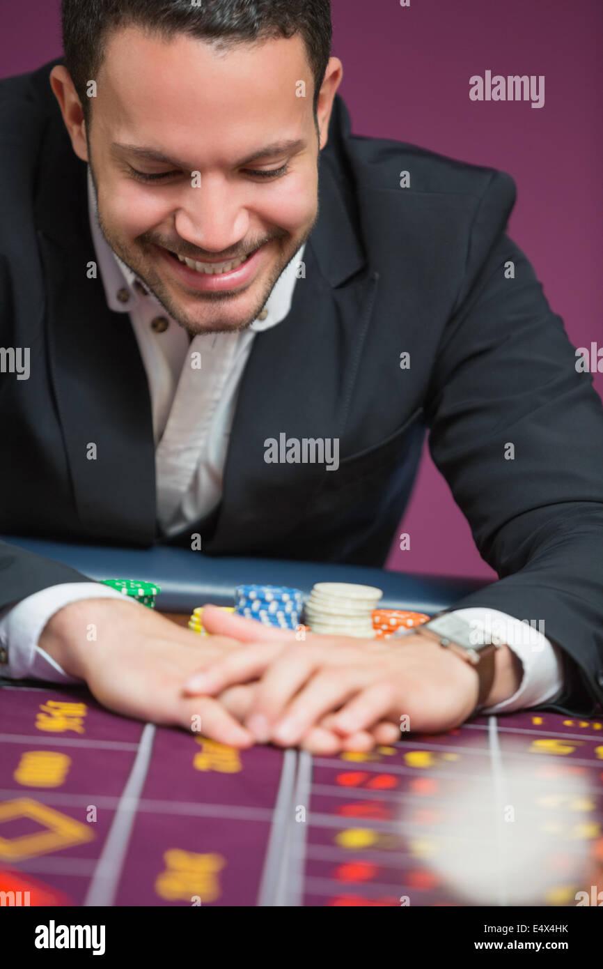 Man happily grabbing chips - Stock Image