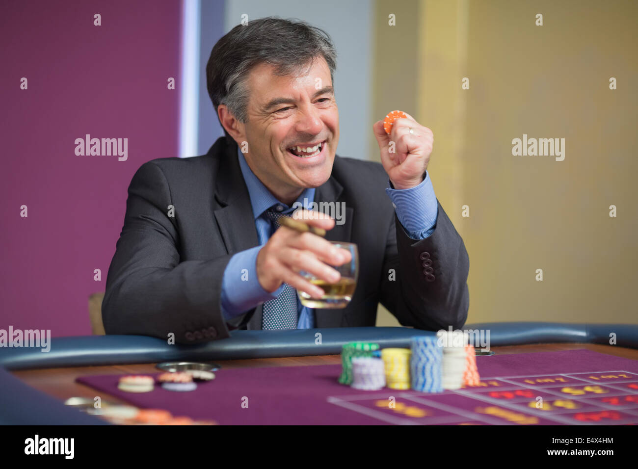 Man winning at roulette table - Stock Image