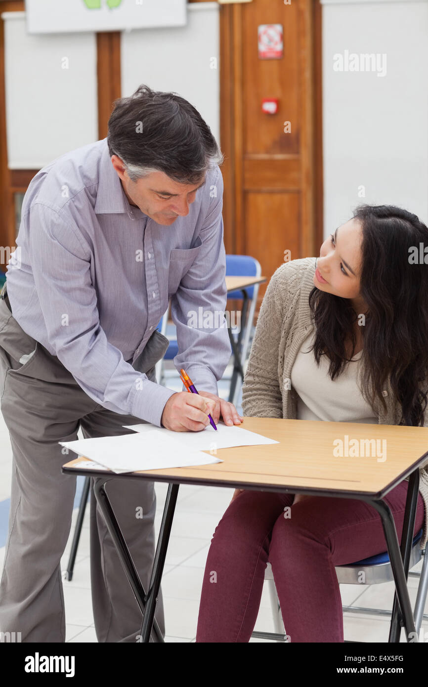 Teacher helping student with work - Stock Image