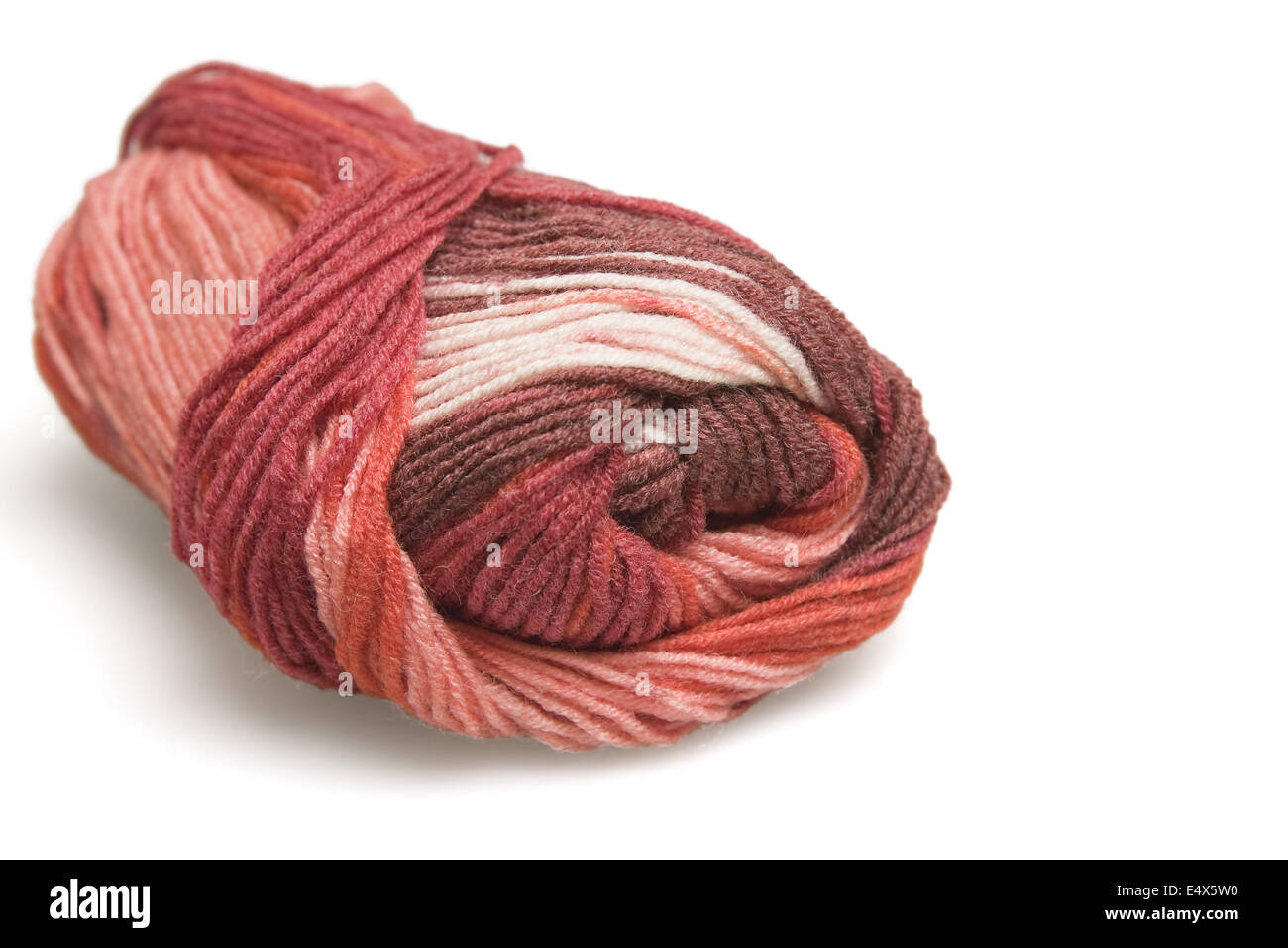 skein of wool in red on a white background - Stock Image