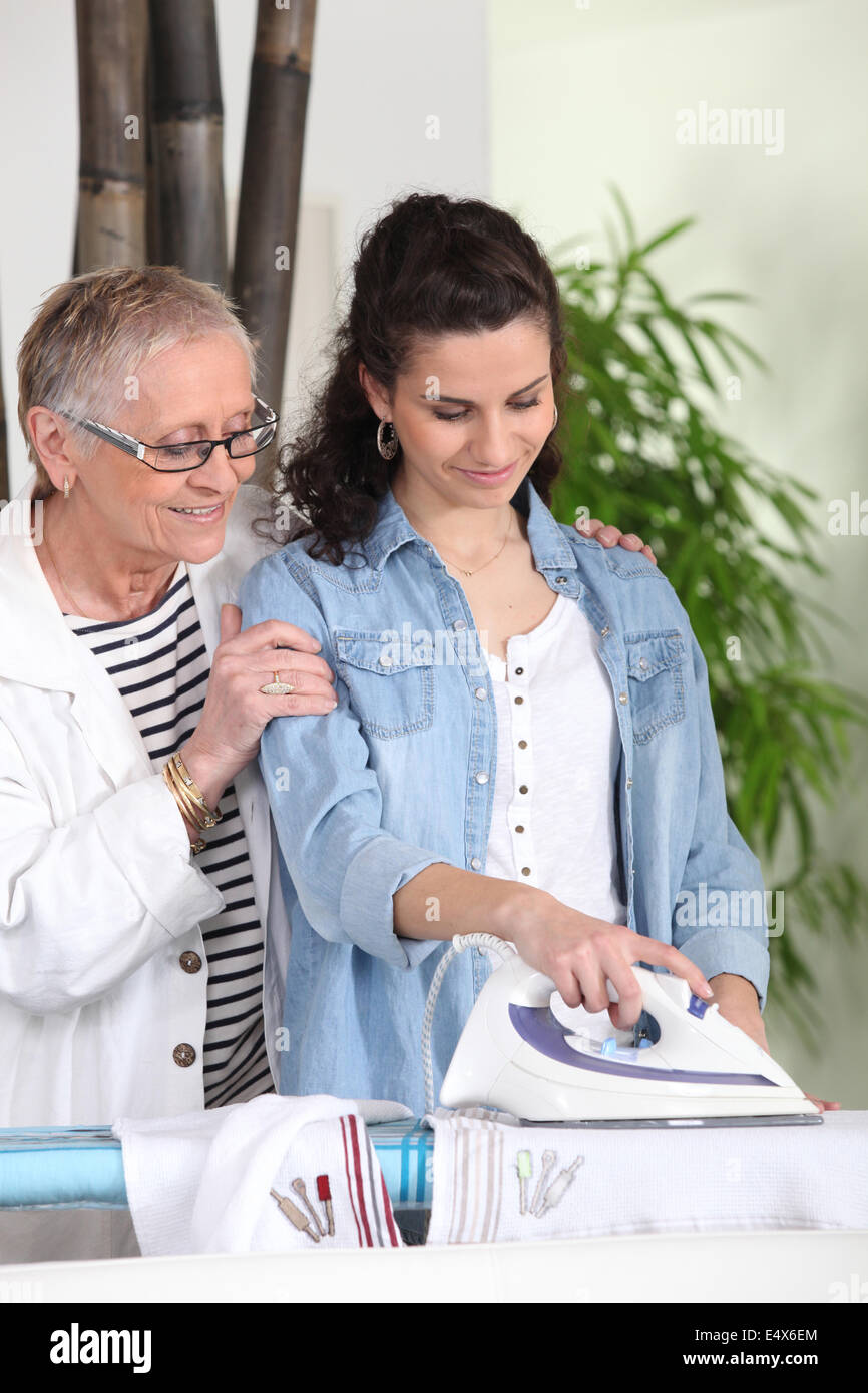 Young woman ironing - Stock Image