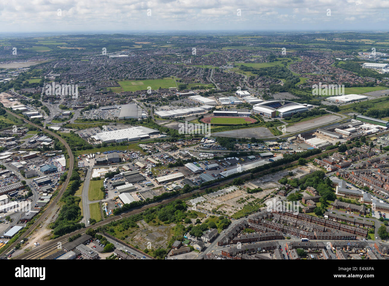 An aerial view of Wigan showing industrial areas and the JJB Stadium, home of Wigan Athletic FC - Stock Image