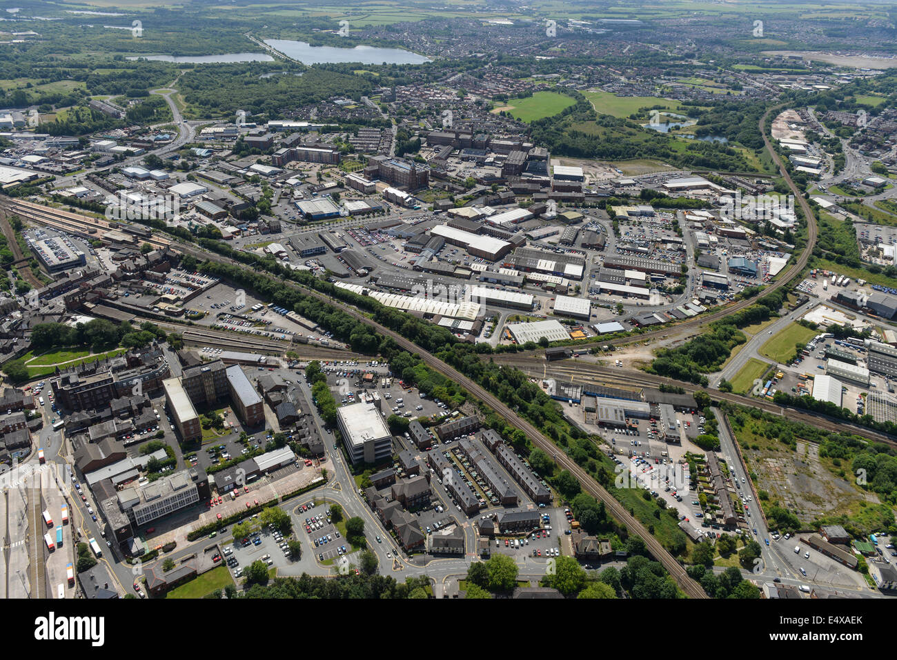 An aerial view of Wigan showing industrial areas and the railway around the town centre. - Stock Image