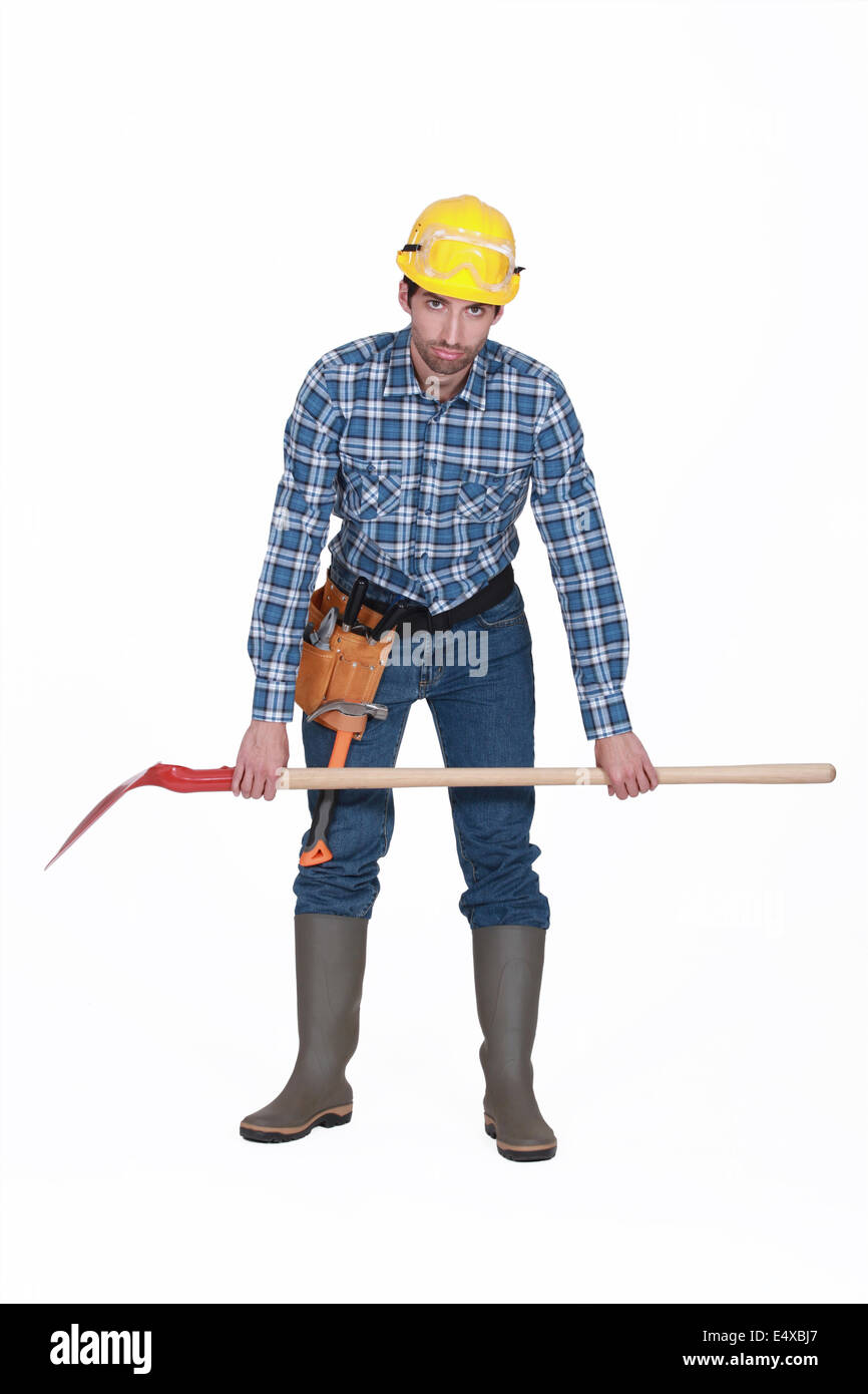 Tired builder with spade Stock Photo
