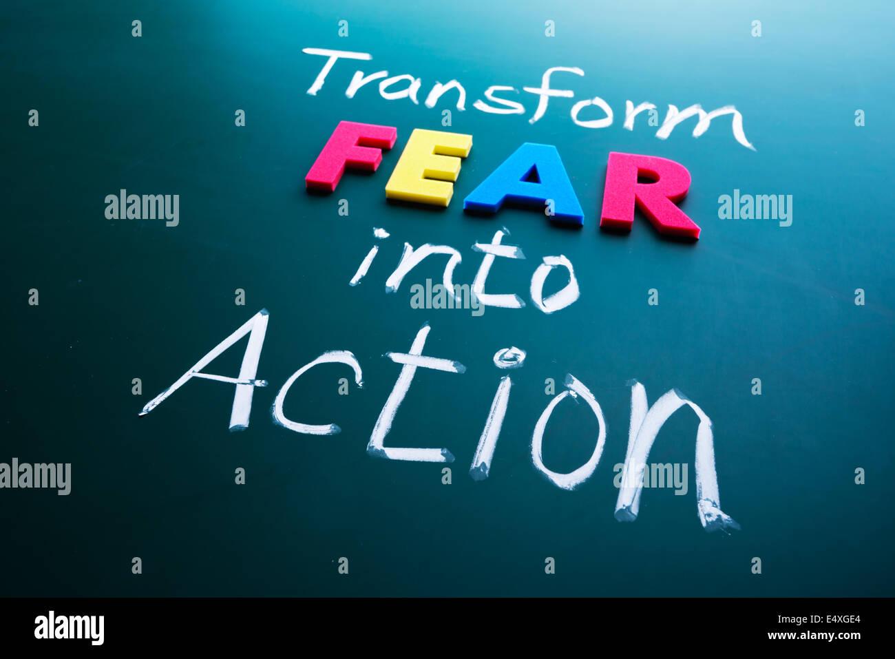 Transform fear into action concept - Stock Image