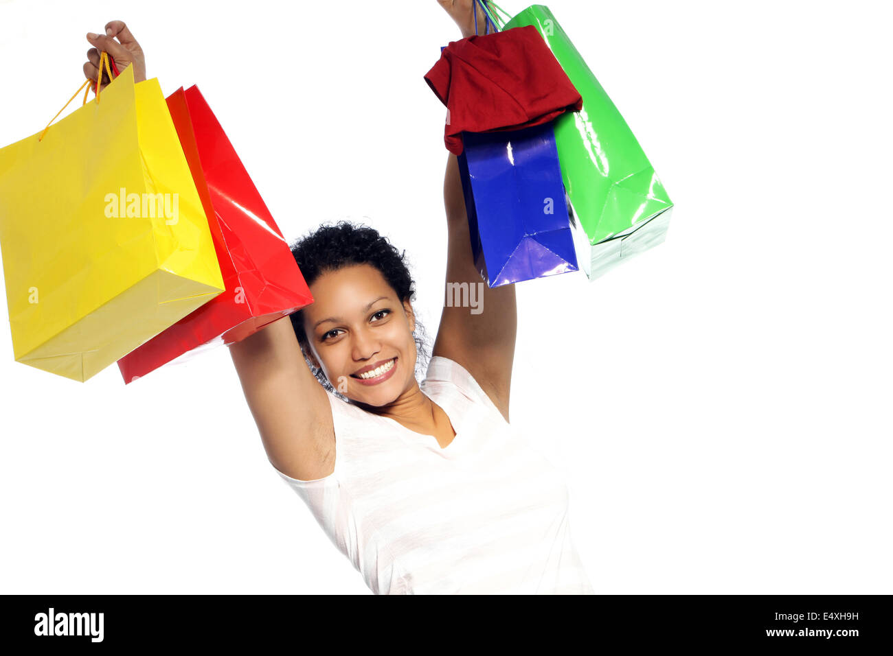 Rejoicing woman with her shopping - Stock Image