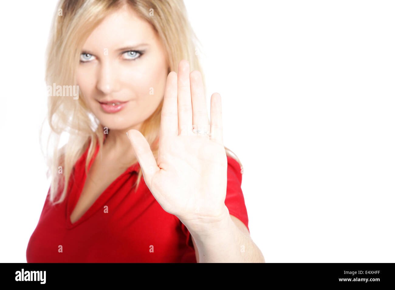 Woman making a cease and desist gesture - Stock Image