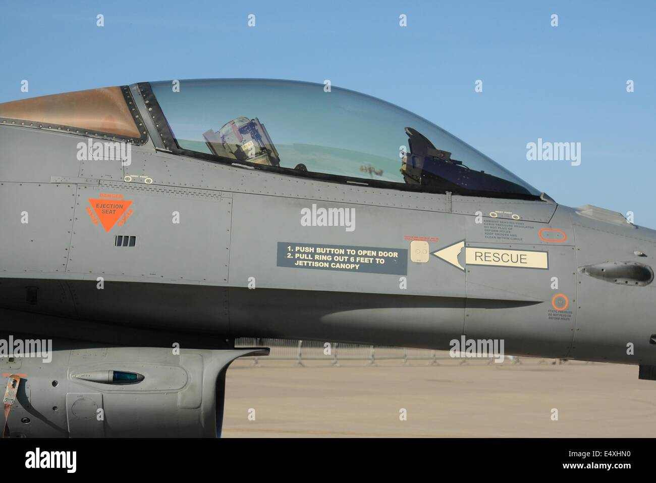Closeup of F16 Fighting Falcon aircraft cockpit showing canopy glass - Stock Image