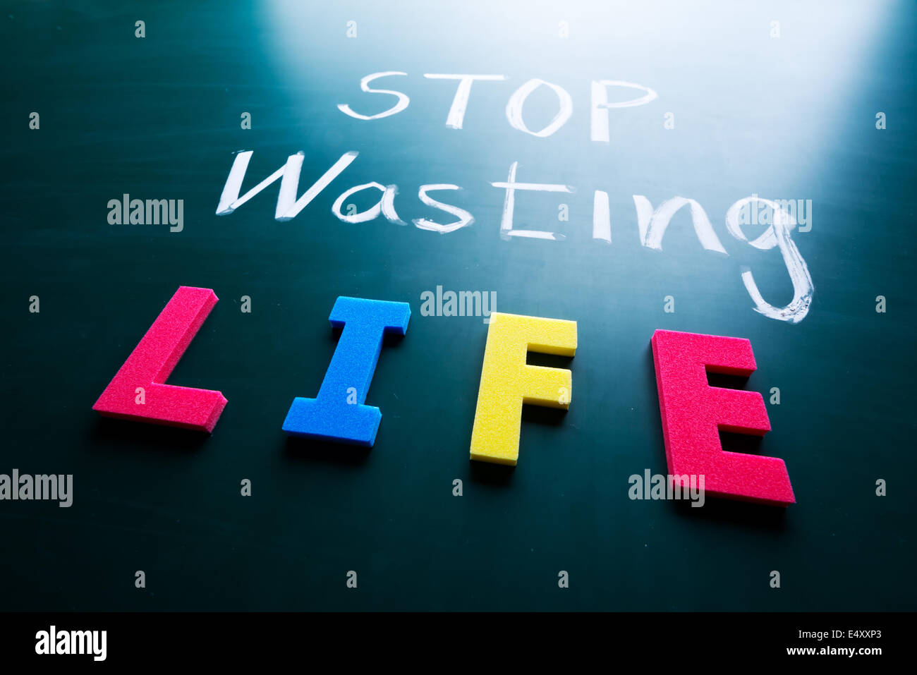 Stop wasting life concept - Stock Image