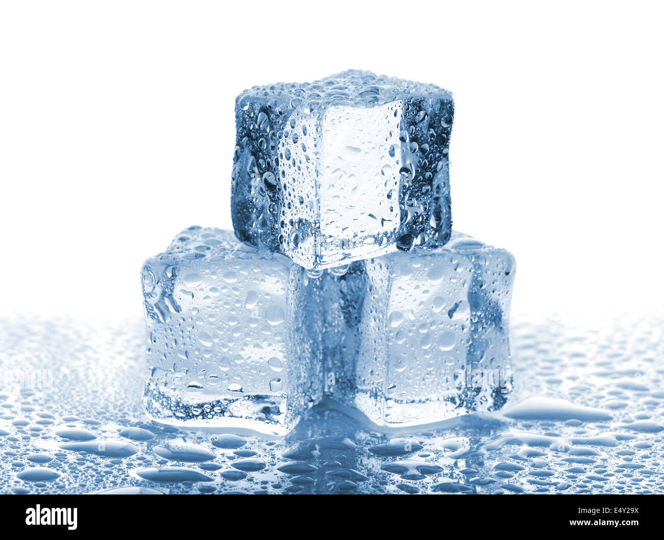 Three ice cubes with water drops - Stock Image