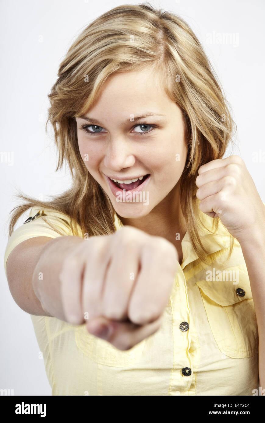 Young woman strikes Stock Photo