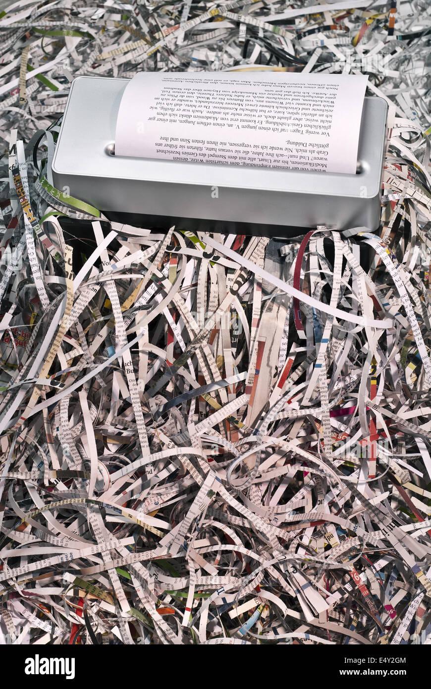 Shredder and shredded documents - Stock Image