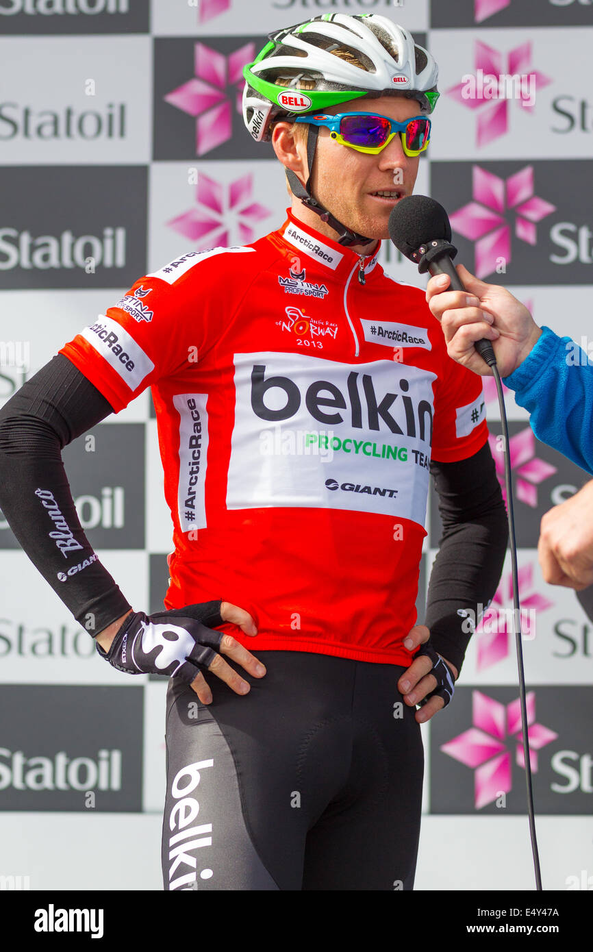 Belkin Pro cyclist Lars Petter Nordhaug being interviewed with the red climbers jersey before a stage in Arctic - Stock Image