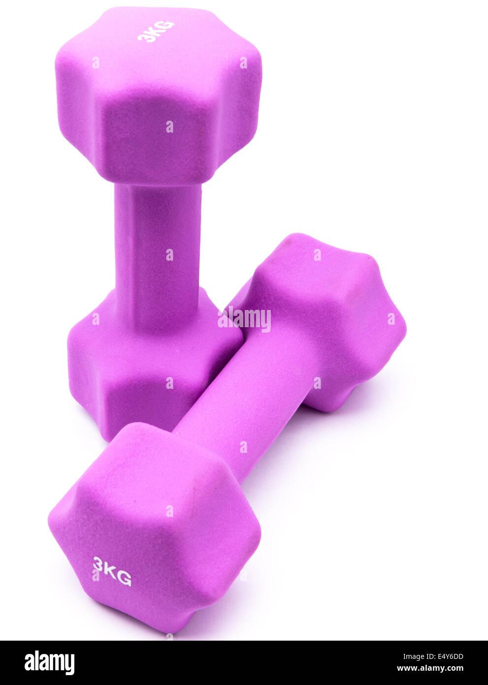 Pink 3 kg dumbbells - Stock Image